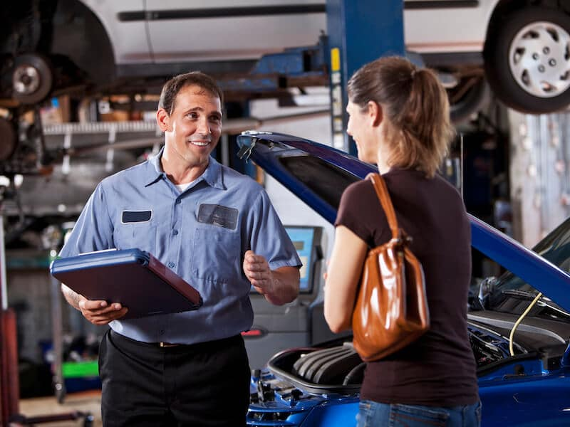 A mechanic talking to a customer