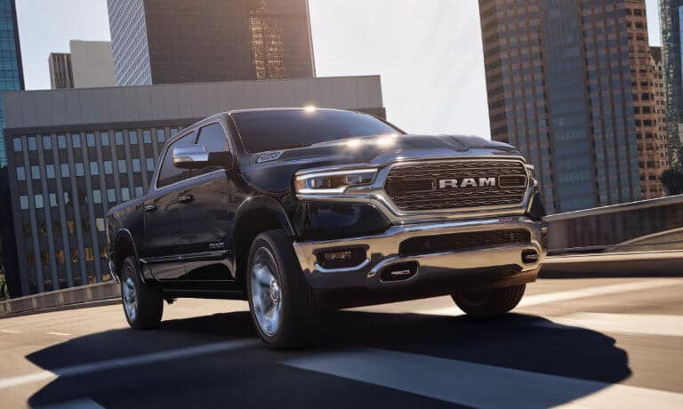 2021 Ram 1500 exterior driving in city head on