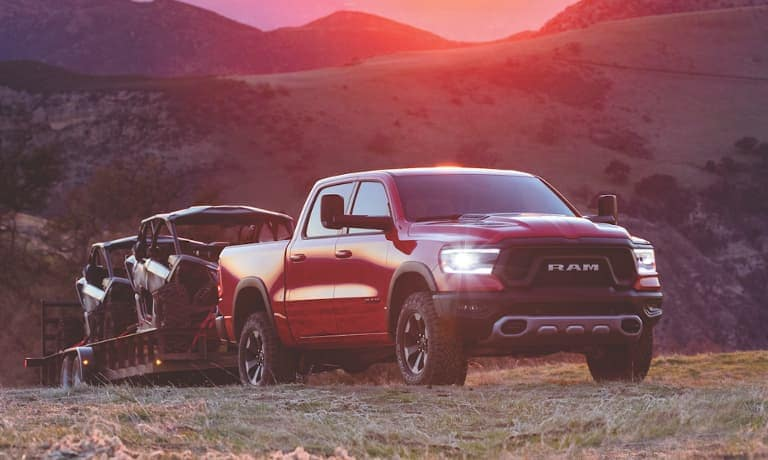 2021 Ram 1500 towing at sunset