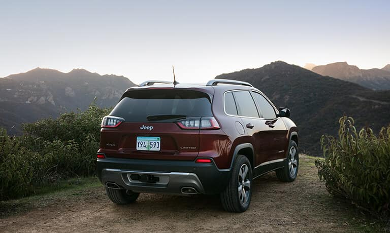 2021 Jeep Cherokee Exterior Parked On A Cliff Against Some Mountains