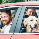 Family in Car with Dog