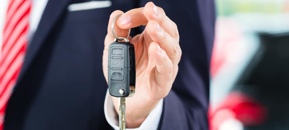 Auto salesperson holding keys