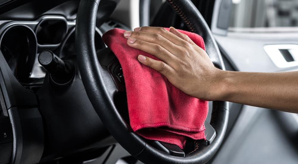 Hand Wiping Down Car Interior