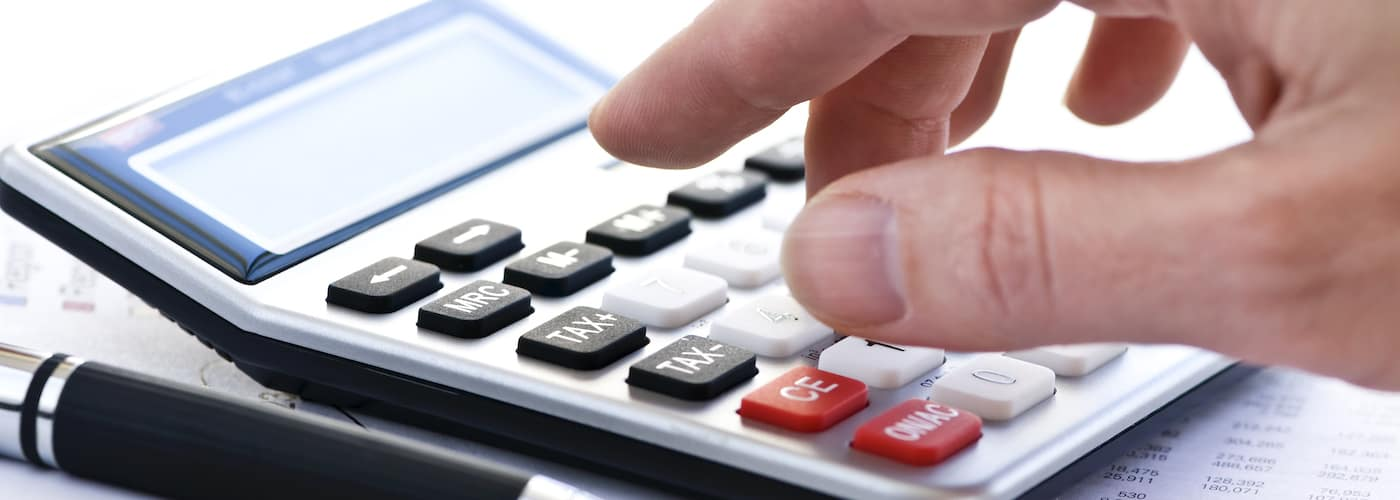 Hand Using a Calculator