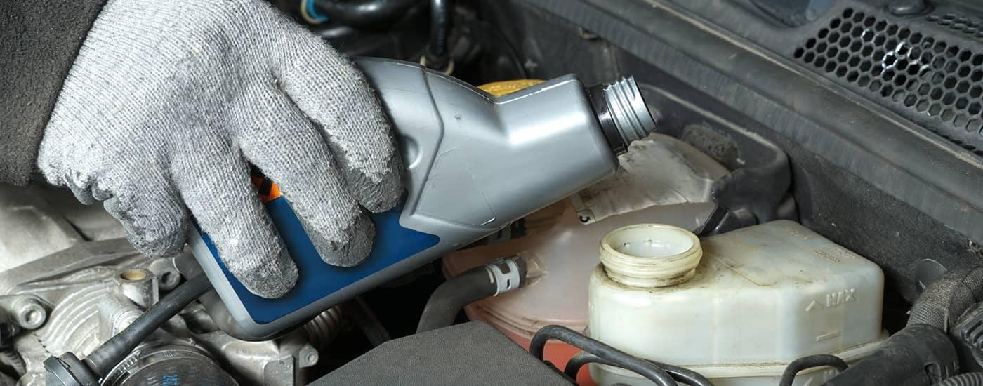 Mechanic adding brake fluid