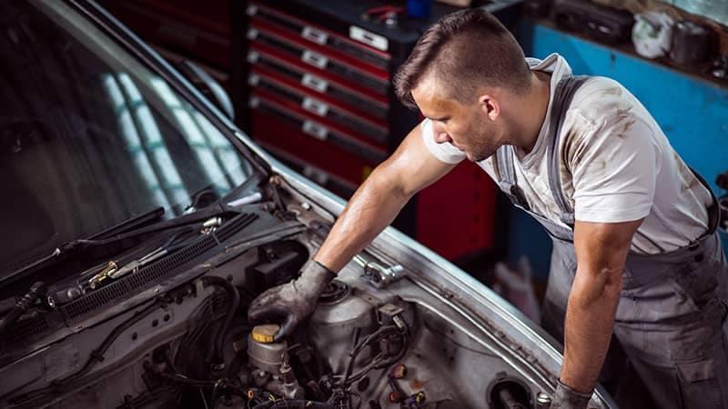 Mechanic checking brake fluid