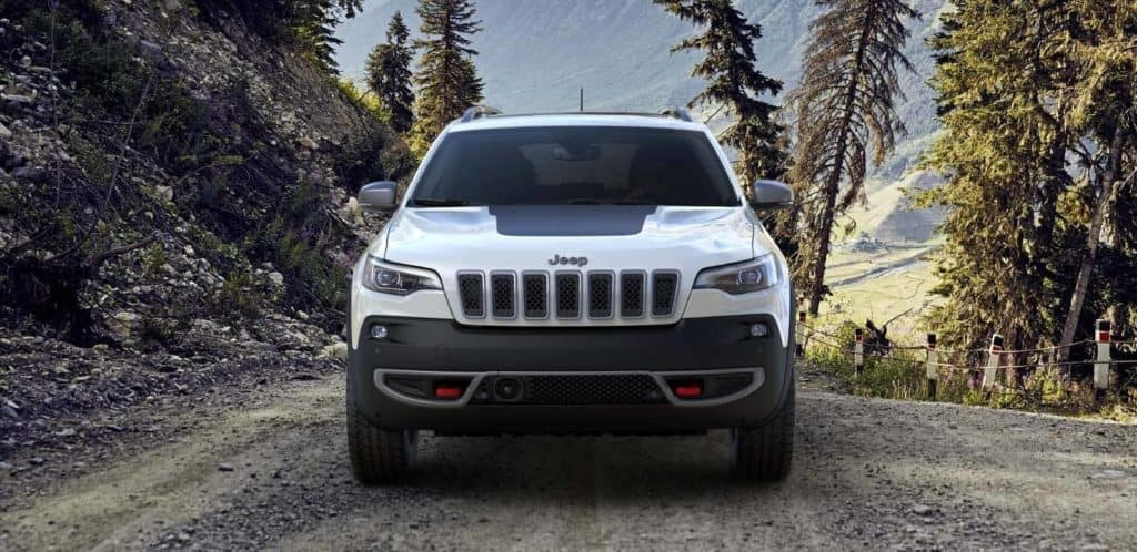 White Jeep Cherokee Trailhawk Leaving Forest