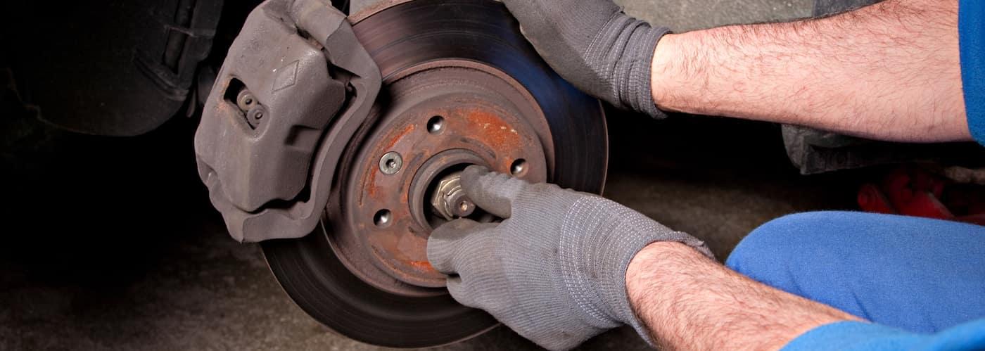 Mechanic Changing Brake ROtors