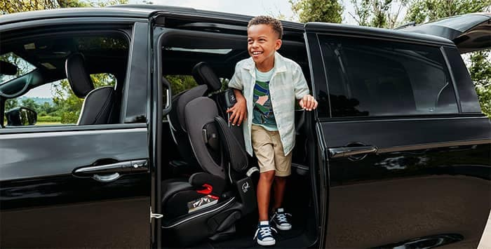 Boy getting out of 2020 Chrysler Pacficia