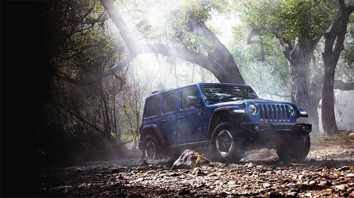 Blue Jeep Wrangler Off-Roading