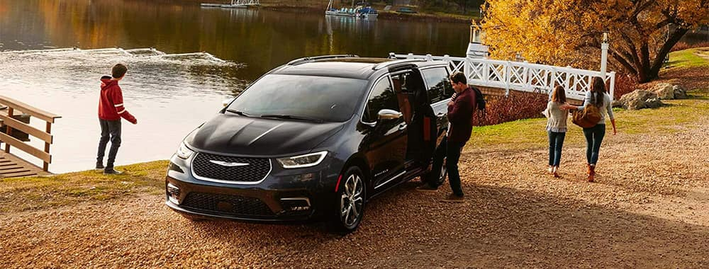 Chrysler Pacifica Hybrid Parked by Lake with Family