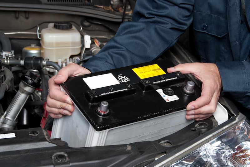Battery being removed from a car