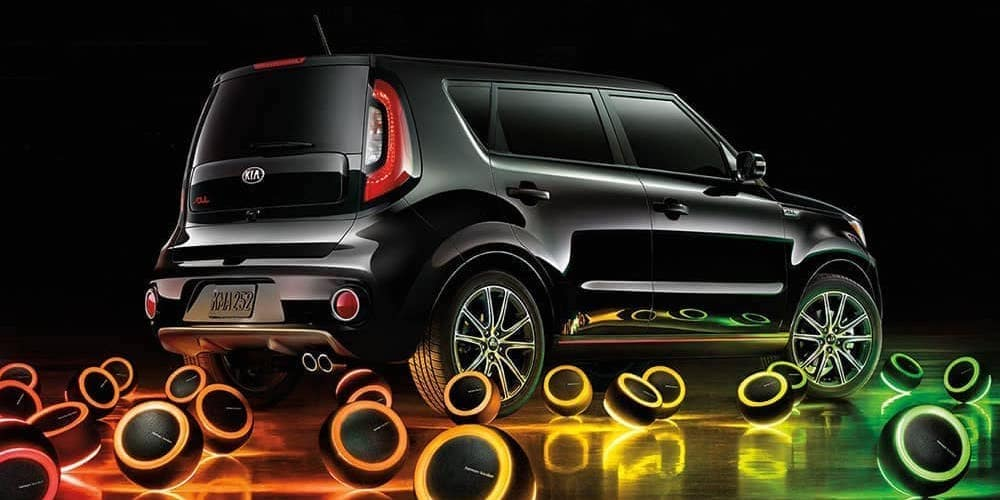 Black Kia Soul with Neon Speakers Outside