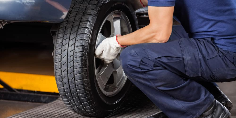 Mechanic Removing Tire