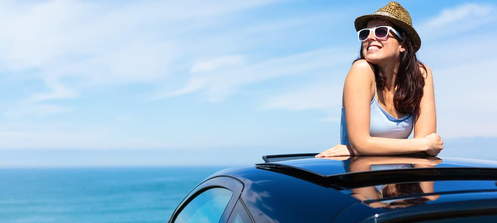 Woman Standing Through Sunroof