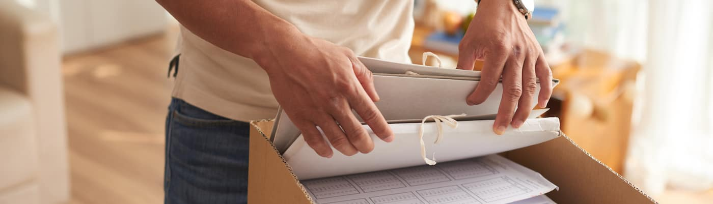 Man Sorting Through More Documents Than You Need to Buy a Car