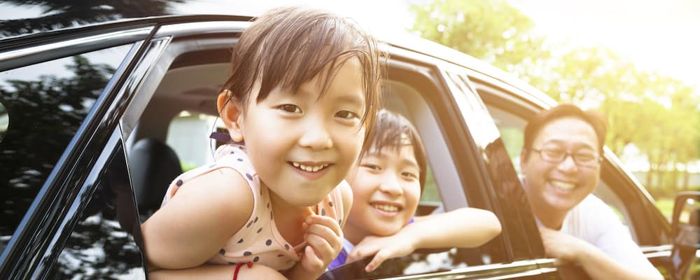 Happy Family in Crossover SUV