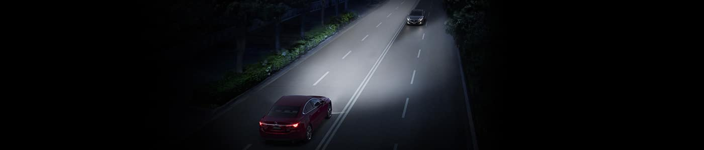 Two Vehicles on the Road at Night