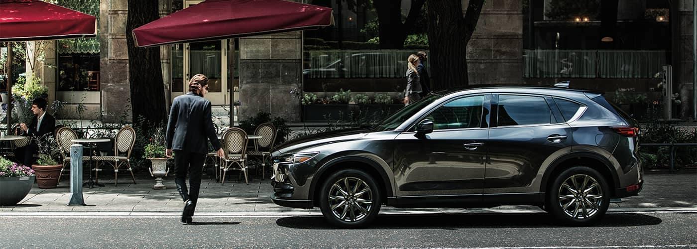 Man walking by Mazda CX-5