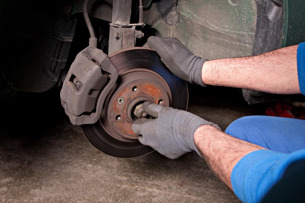 Mechanic's Hands on Brake Rotor