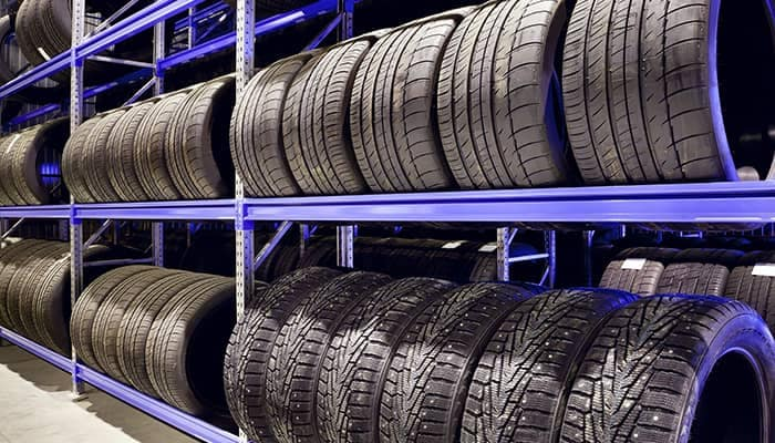 Tires Lined Up On Shelf