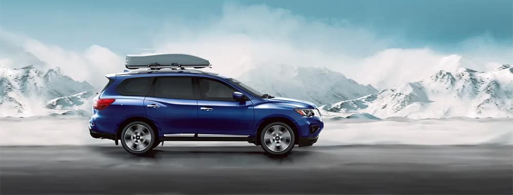 Nissan Pathfinder with Cargo Carrier on Roof Rock