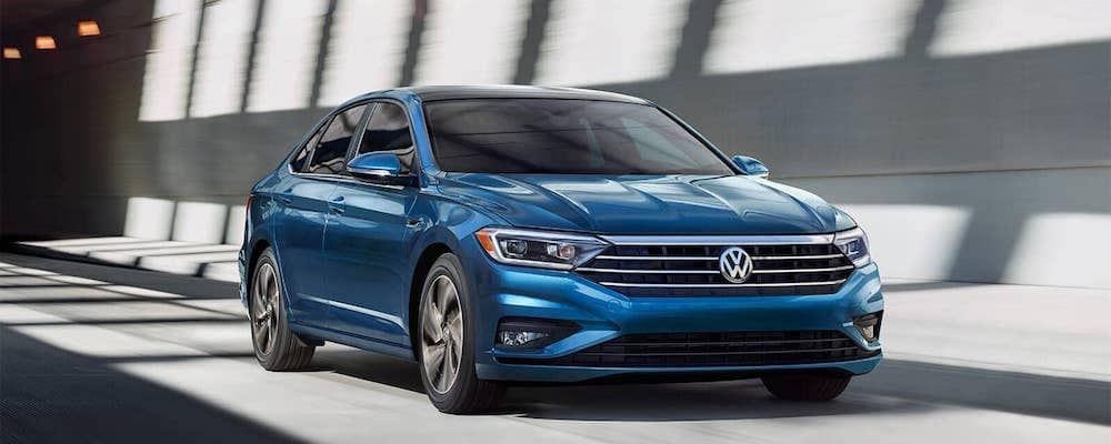 2019 Jetta SEL premium in silk blue metallic driving