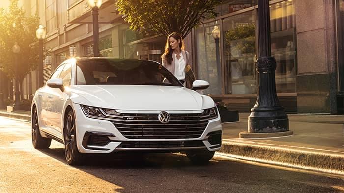 Woman getting into VW Arteon