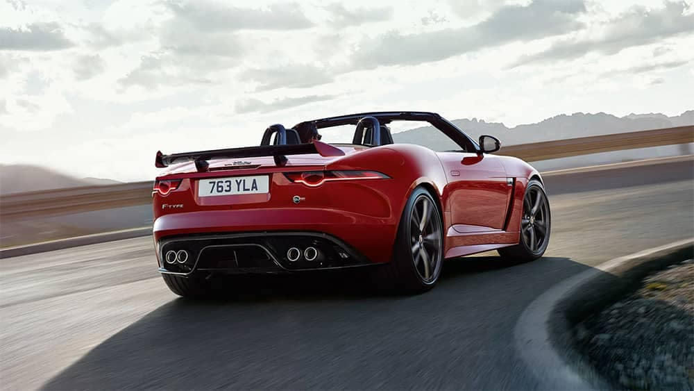 2020-Jaguar-F-TYPE-SVR-Convertible-in-Caldera-Red-driving-around-corner