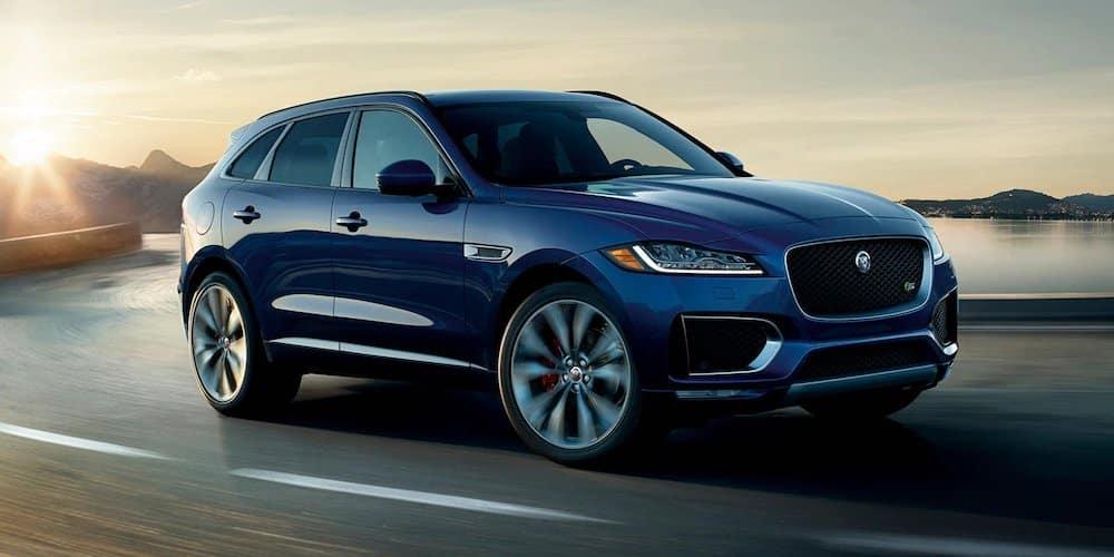Blue 2020 Jaguar F-PACE on Highway