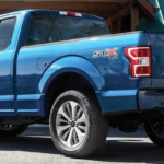 2019 F-150 parked outside of a house
