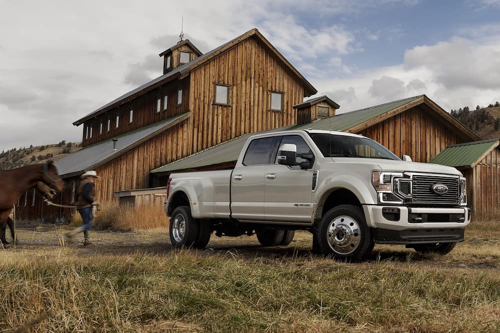 2020 Ford Super Duty F-450 parked near a barn