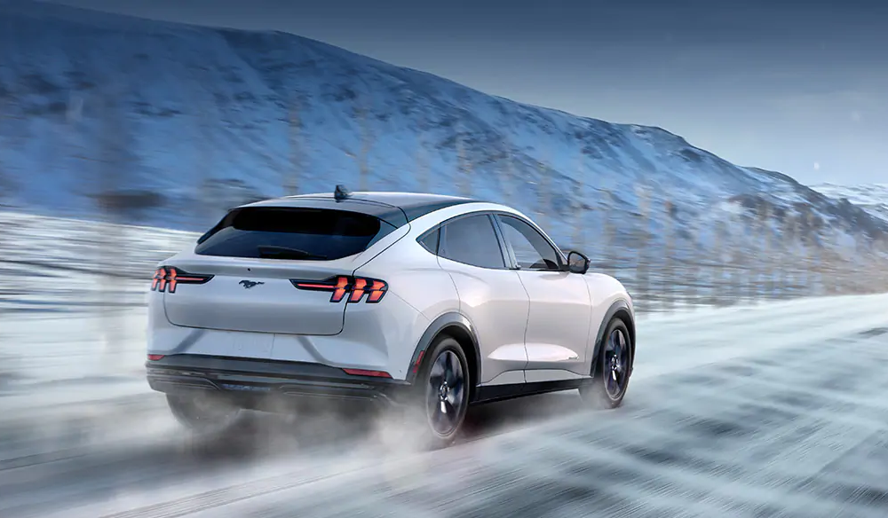 2021 Mustang Mach-E SUV driving in the snow