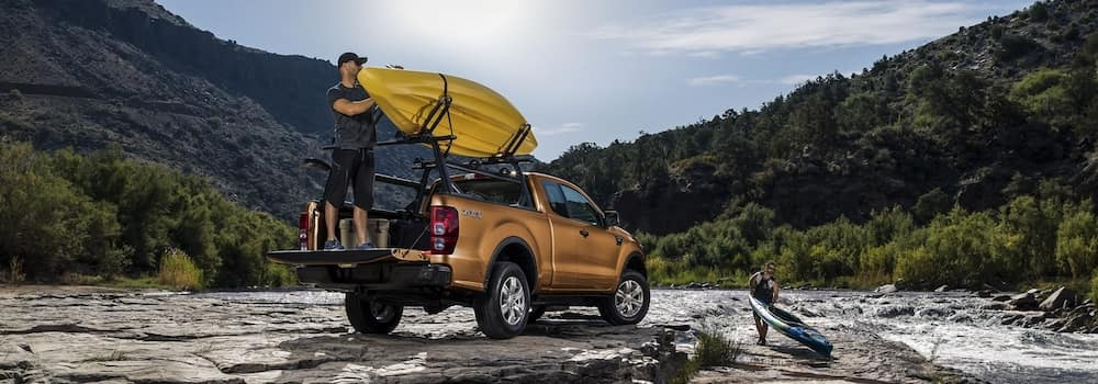 Man standing in the bed of a 2020 Ranger