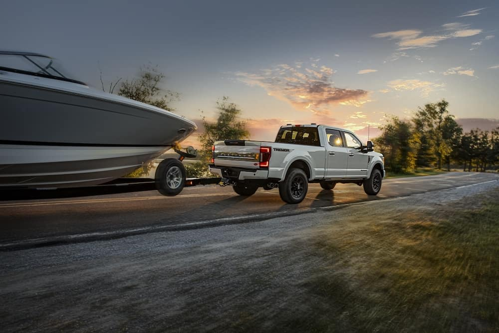 2020 Ford F-250 Platinum Crew Cab towing a boat