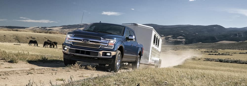 2020 Ford F150 towing a trailer on a dirt road