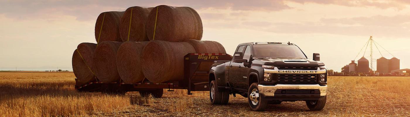 2020 Silverado HD with a trailer full of hay bales