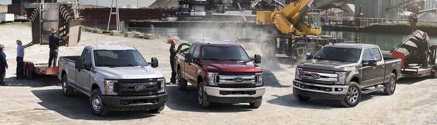 Ford Super Duty trucks at a job site