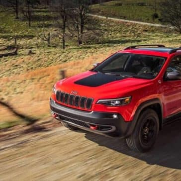 2019 Jeep Cherokee driving on dirt road