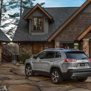 2019 Jeep Cherokee parked by large home