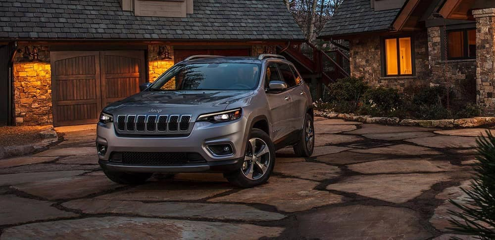 2019 Jeep Cherokee forward facing parked outside house