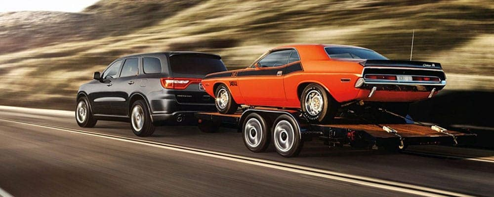 2018-Dodge-Durango-Towing-Vehicle-on-Highway