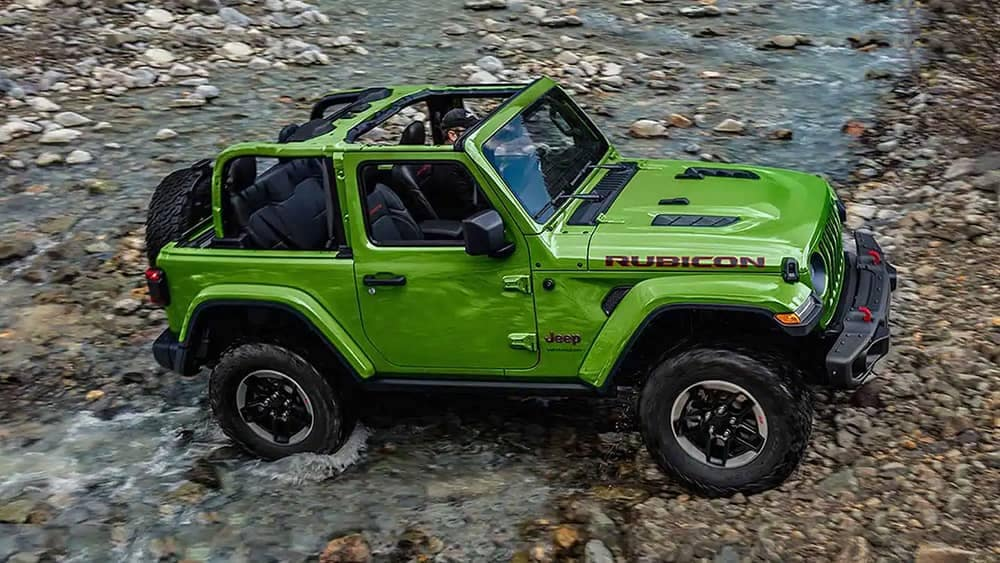 2019 Jeep Wrangler in green without top, offroading