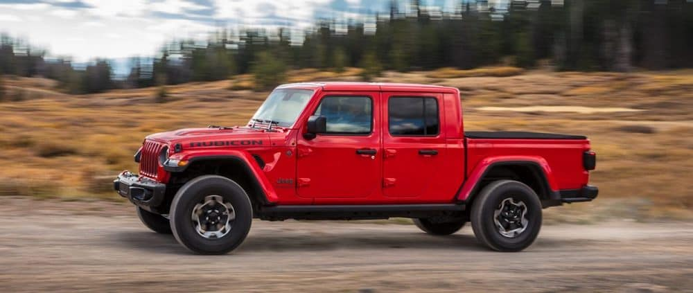 A 2020 Jeep Gladiator Driving on a Dirt Road in the Country