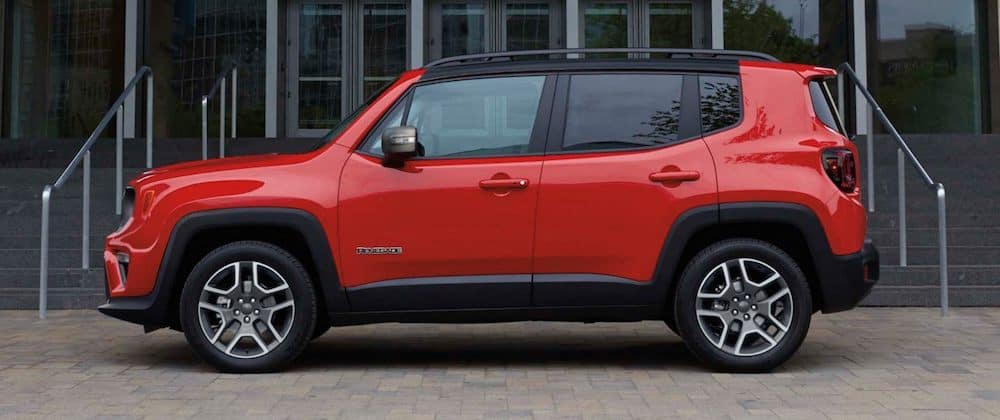 A 2020 Jeep Renegade parked in front of a building