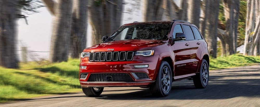 A 2020 Jeep Grand Cherokee driving on a country road