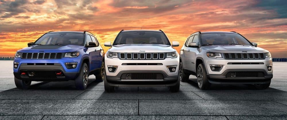 3 Jeep 2020 Jeep Compass models parked with the sunset in the background