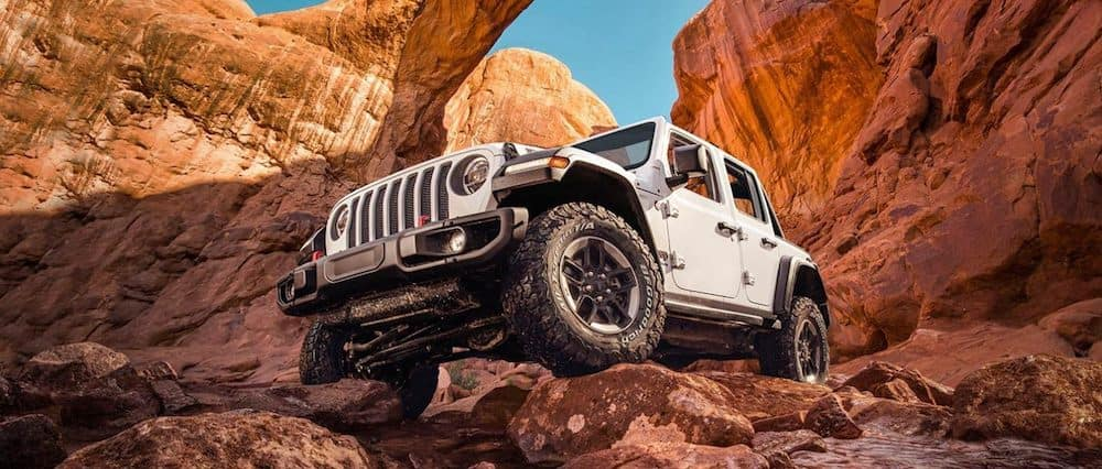 A 2020 Jeep Wrangler parked on large rocks