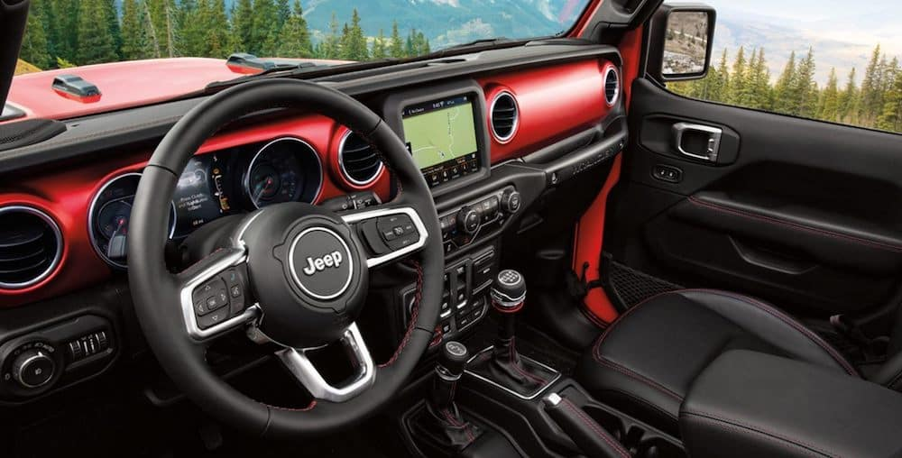 Front seats and dash inside a new 2020 Jeep Wrangler