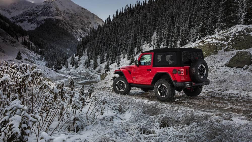 2018 Jeep Wrangler on snowy mountain road
